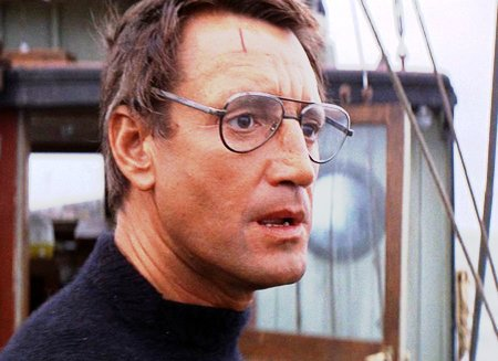 Captain Brody looks out to sea worried from the deck of the Orca. From the film Jaws. Thomas Editing