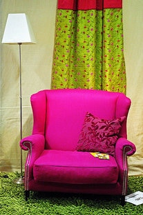 Bright pink armchair in a sitting room to illustrate Thomas Editing blog